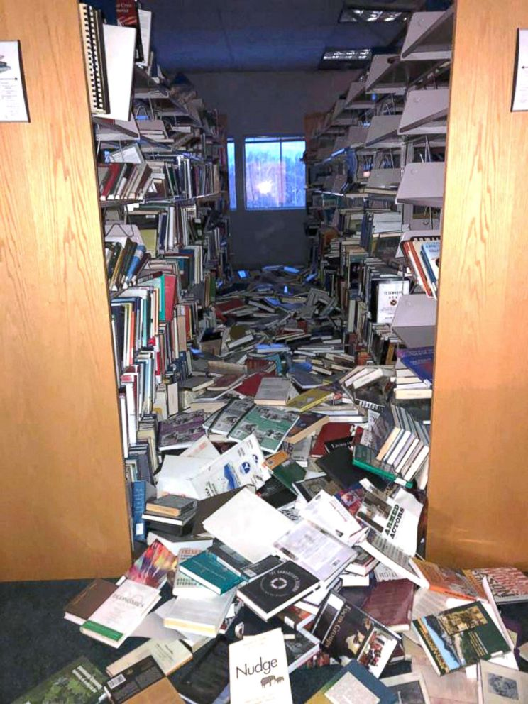 PHOTO: In this courtesy image books and ceiling tiles litter the floor at the The Mat-Su College library in Anchorage, Ala., Nov. 30, 2018.