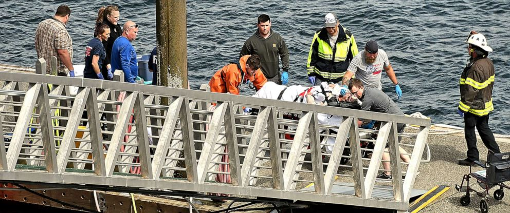 PHOTO: Emergency response crews transport an injured passenger to an ambulance at the George Inlet Lodge docks, Monday, May 13, 2019, in Ketchikan, Alaska.