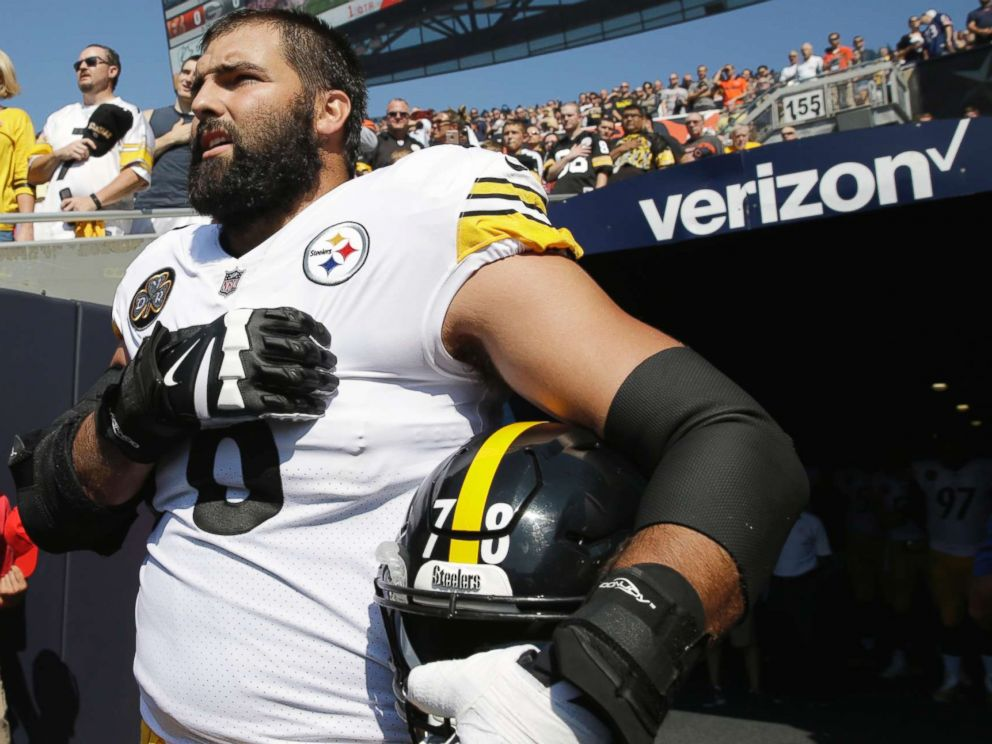 PHOTO: Pittsburgh Steelers offensive tackle and former Army Ranger Alejandro Villanueva stands outside the tunnel alone during the national anthem before an NFL football game against the Chicago Bears, Sept. 24, 2017, in Chicago.