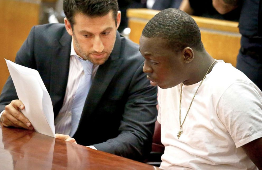 Rapper Bobby Shmurda, whose birth name is Ackquille Pollard, right, confers with his lawyer Alex Spiro in a Manhattan court on Oct. 19, 2016, in New York.
