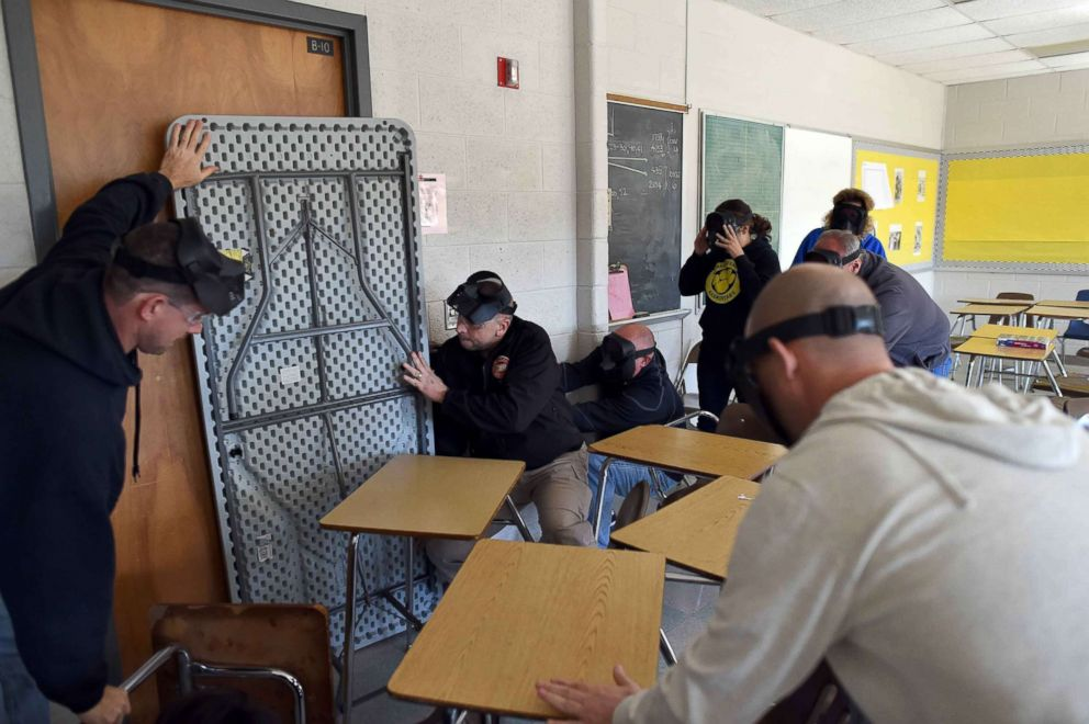 "Participants barricade a door of a classroom to block an ""active shooter"" during ALICE (Alert, Lockdown, Inform, Counter and Evacuate) training at the Harry S. Truman High School in Levittown, Penn., Nov. 3, 2015."
