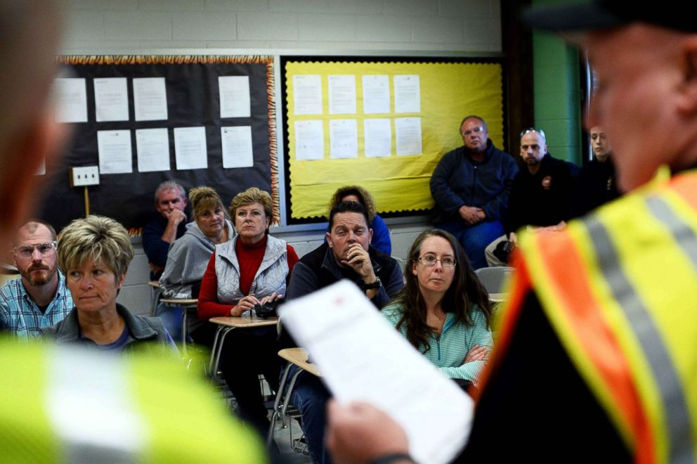 Participants listen to instructors during ALICE (Alert, Lockdown, Inform, Counter and Evacuate) training at the Harry S Truman High School in Levittown, Penn., Nov. 3, 2015.
