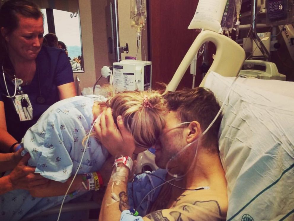 PHOTO: Alix and Brett Epps embrace in the hospital on the day that Alix donated a kidney to Brett.