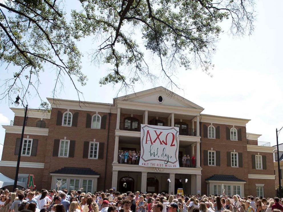 PHOTO: College students gather outside of the Alpha Chi Omega house during the University of Alabama sorority recruitment Bid Day, Saturday, Aug. 19, 2017, in Tuscaloosa, Ala.