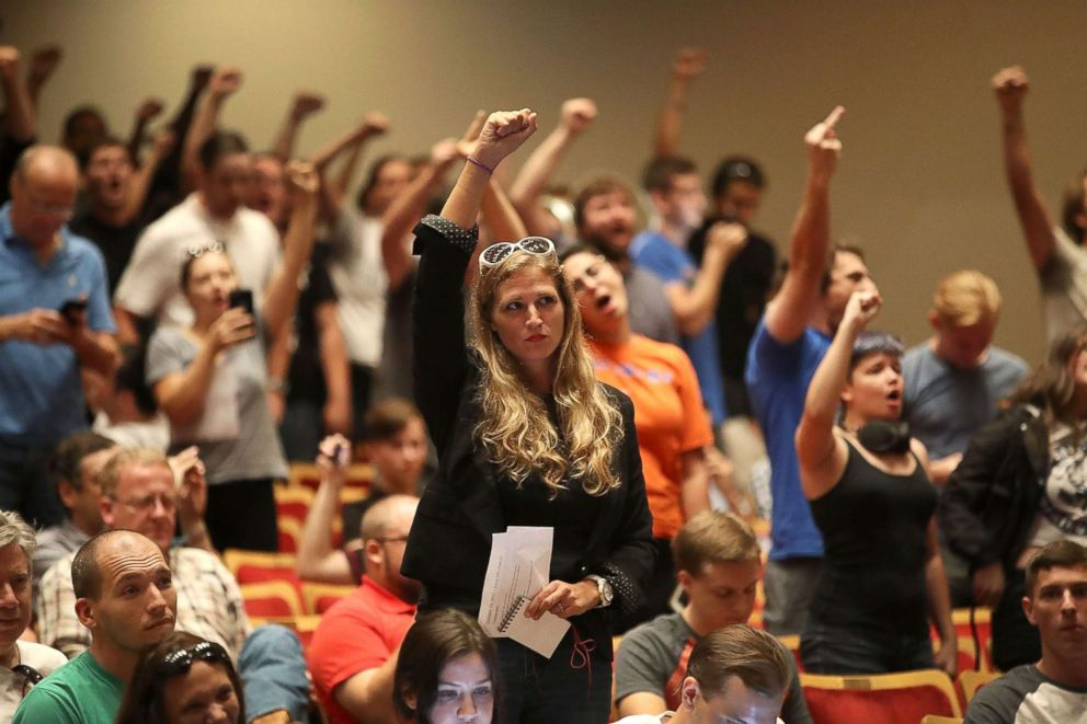 PHOTO: People react as white nationalist Richard Spencer, who popularized the term alt-right speaks at the Curtis M. Phillips Center for the Performing Arts on Oct. 19, 2017 in Gainesville, Fla.