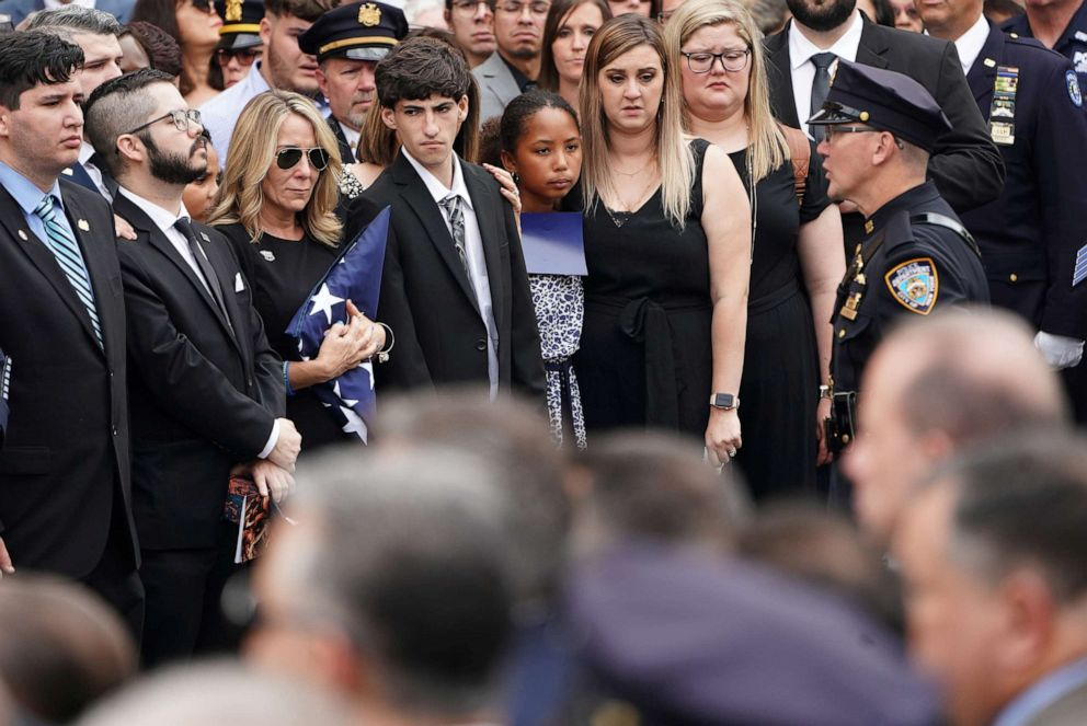PHOTO: Lainie Alvarez clutches the flag from the casket of her husband, former NYPD detective Luis Alvarez at his funeral in New York City, July 3, 2019.