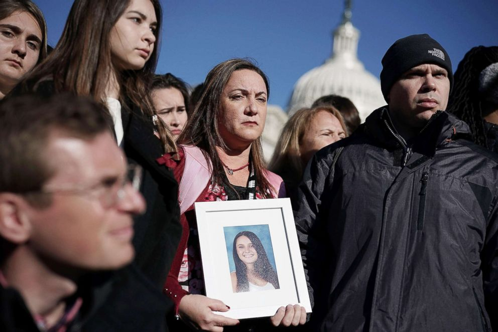 PHOTO: Lori Alhadeff and her husband Ilan Alhadeff right, hold a picture of their daughter Alyssa Alhadeff, a Marjory Stoneman Douglas High School shooting victim, during a news conference on gun control March 23, 2018 on Capitol Hill in Washington, D.C.