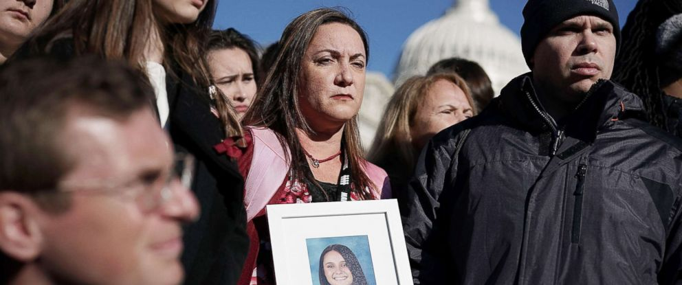PHOTO: Lori Alhadeff and her husband Ilan Alhadeff right, hold a picture of their daughter Alyssa Alhadeff, a Marjory Stoneman Douglas High School shooting victim, during a news conference on gun control in Washington, D.C., March 23, 2018.