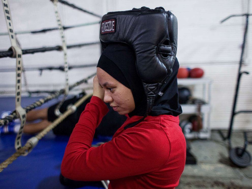 PHOTO: Amaiya wears her hijab under her helmet as she prepares to spar at Circile of Discipline gym.