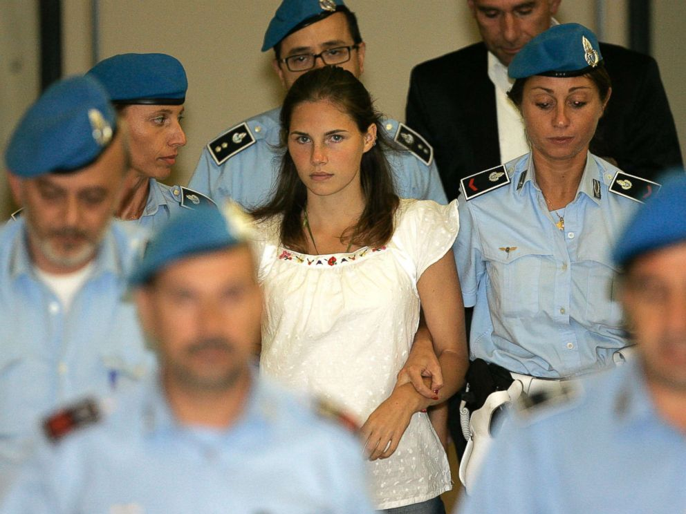 PHOTO: Amanda Knox, center, is escorted by Italian penitentiary police officers from Perugias court after a hearing in central Italy in this Sept. 16, 2008 file photo.