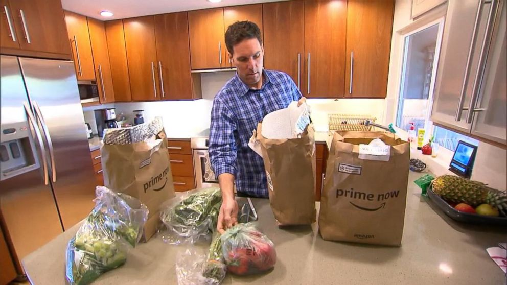 PHOTO: Steve Enders unpacks produce from an Amazon Prime Now grocery delivery order for GMA.
