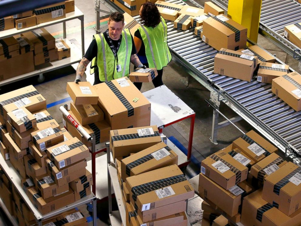 PHOTO: Amazon.com employees organize outbound packages at an Amazon.com Fulfillment Center on Cyber Monday the busiest online shopping day of the holiday season, in Phoenix, Dec. 2, 2013.