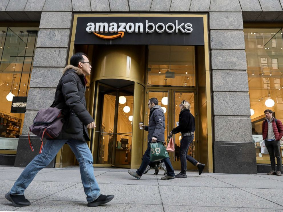 PHOTO: People walk past an Amazon Books retail store in New York, Feb.14, 2019.