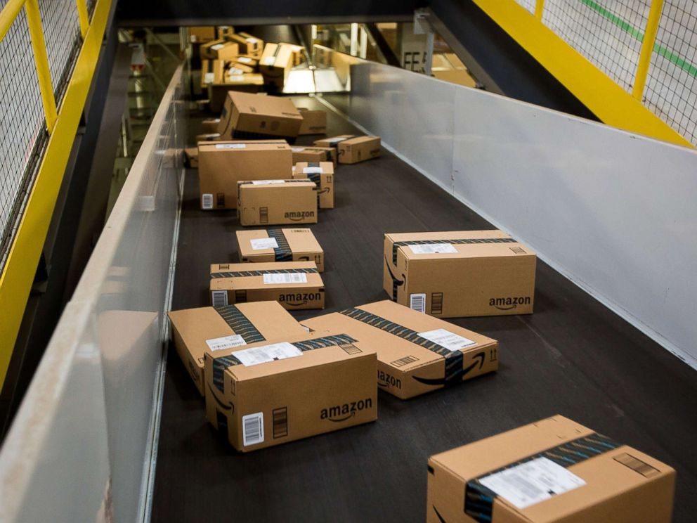 PHOTO: Boxes move along a conveyor belt at an Amazon.com Inc. fulfillment center in New Jersey, Nov. 30, 2015.