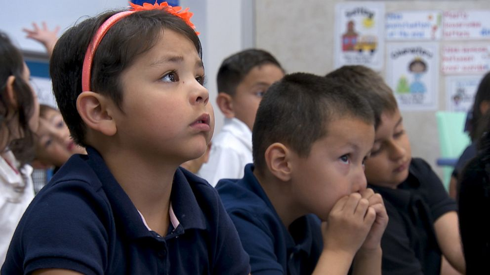 PHOTO: Amelia Guana, a 5 year old kindergartener, listens during active shooter training.