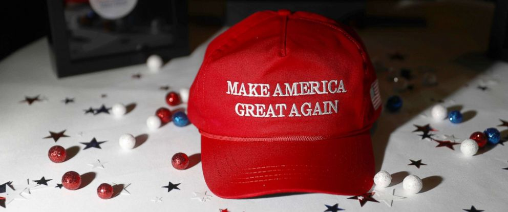 "PHOTO: A ""Make America Great Again"" hat sits on a table ahead of an election night party for 2016 Republican Presidential Nominee Donald Trump at the Hilton Midtown hotel in New York, Nov. 8, 2016."