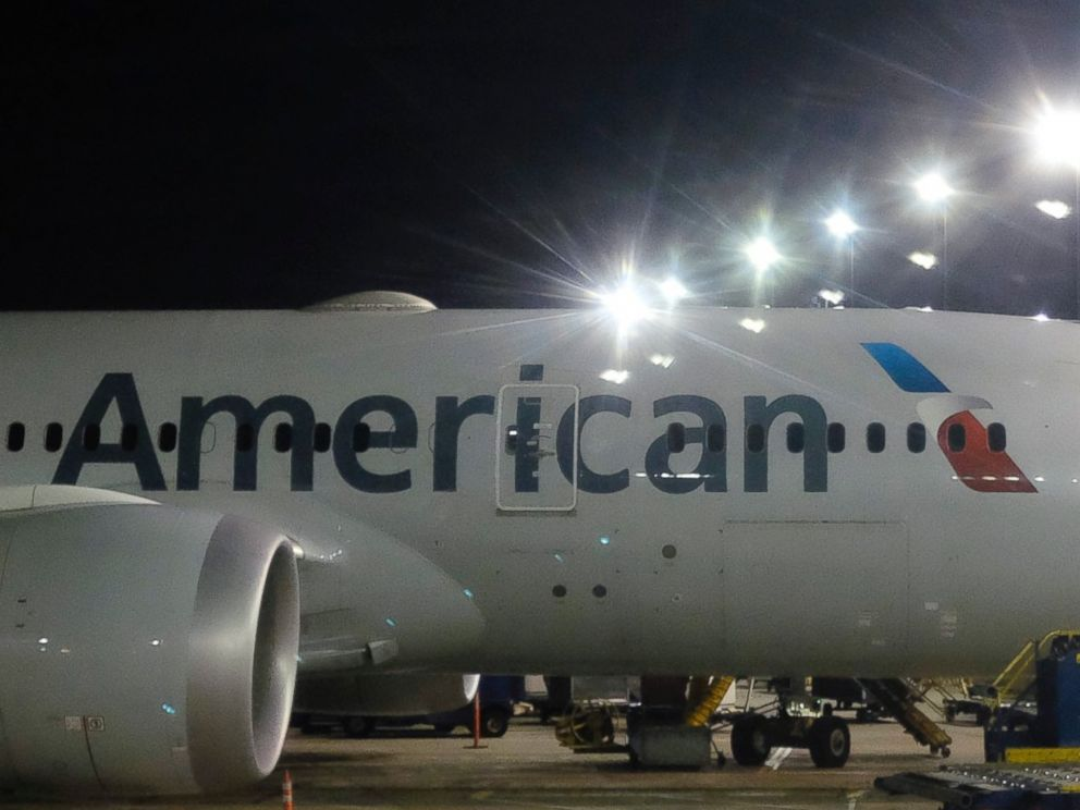 This Nov. 25, 2017 file photo shows an American Airlines plane parked at a gate.