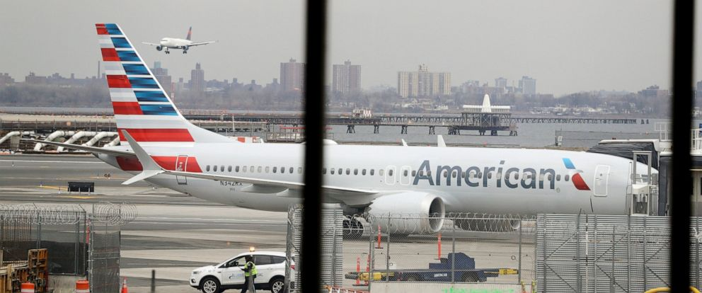 PHOTO: In a March 13, 2019 file photo, an American Airlines Boeing 737 MAX 8 sits at a boarding gate at LaGuardia Airport in New York.