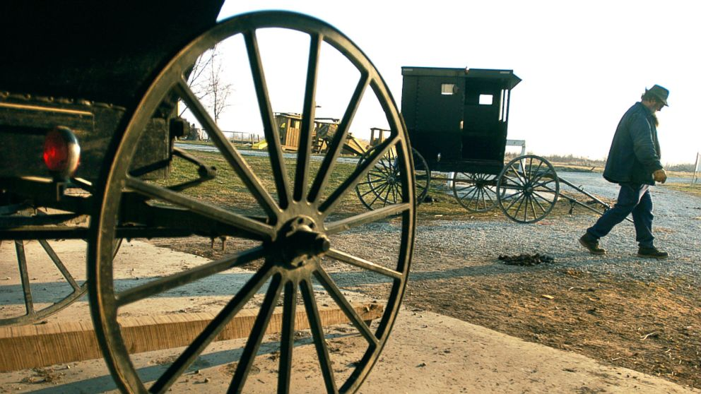 An Amish man who lives just outside of Jamesport, Mo., readies a buggy for travel, March 16, 2005.