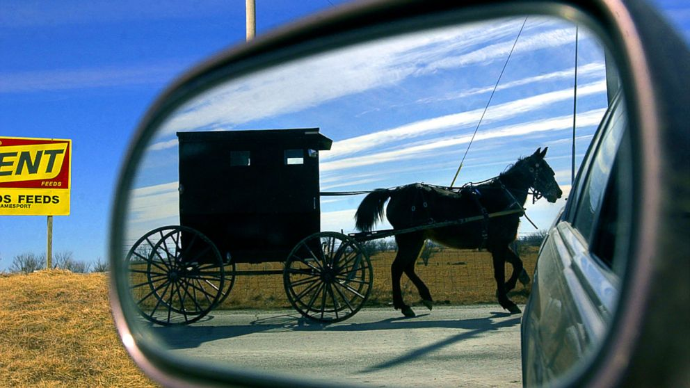 An Amish horse and buggy travel along the country roads leaving the small town of Jamesport, Mo., Feb. 12, 2002.
