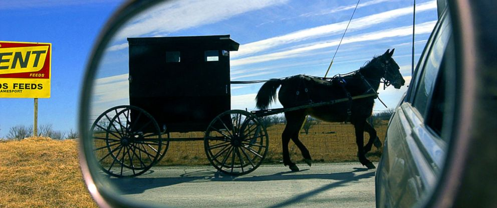 PHOTO: An Amish horse and buggy travel along the country roads leaving the small town of Jamesport, Mo., Feb. 12, 2002.