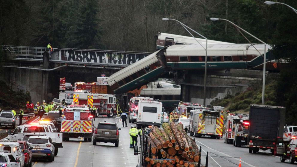 A derailed train is seen on southbound Interstate 5 on Dec. 18, 2017, in DuPont, Wash.