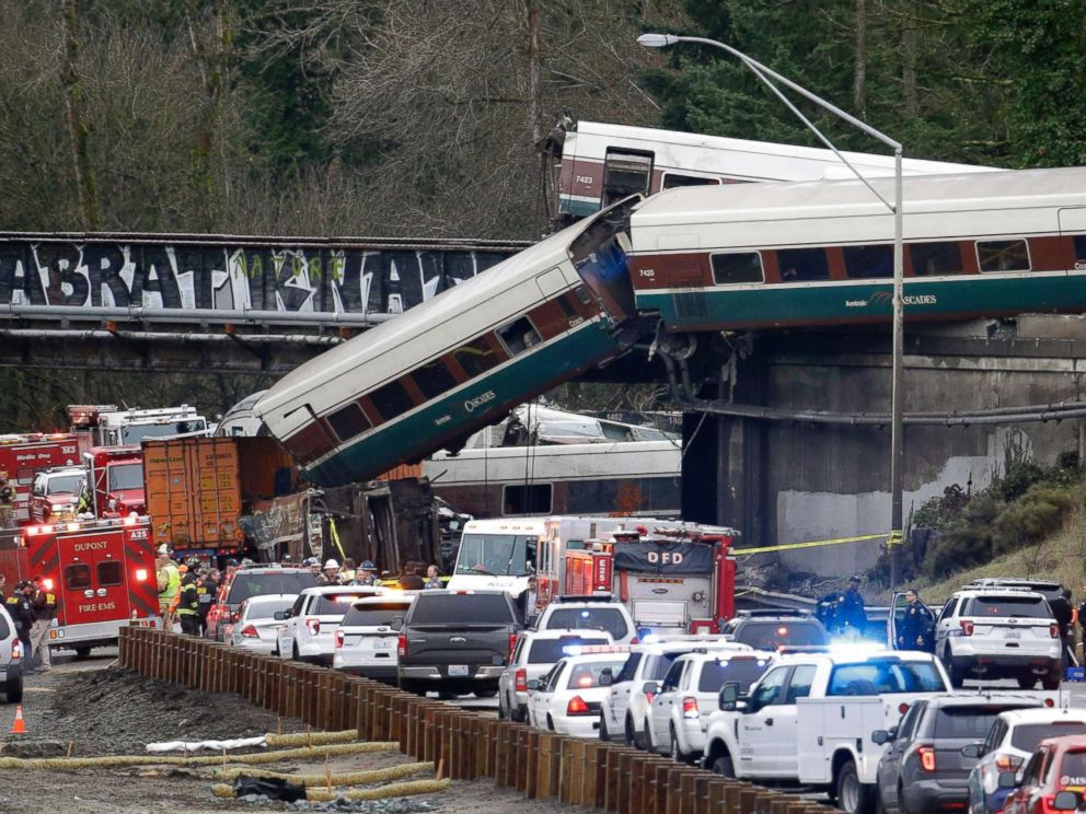 PHOTO: Cars from an Amtrak train lay spilled onto Interstate 5 below as some remain on the tracks above, Dec. 18, 2017, in DuPont, Wash.