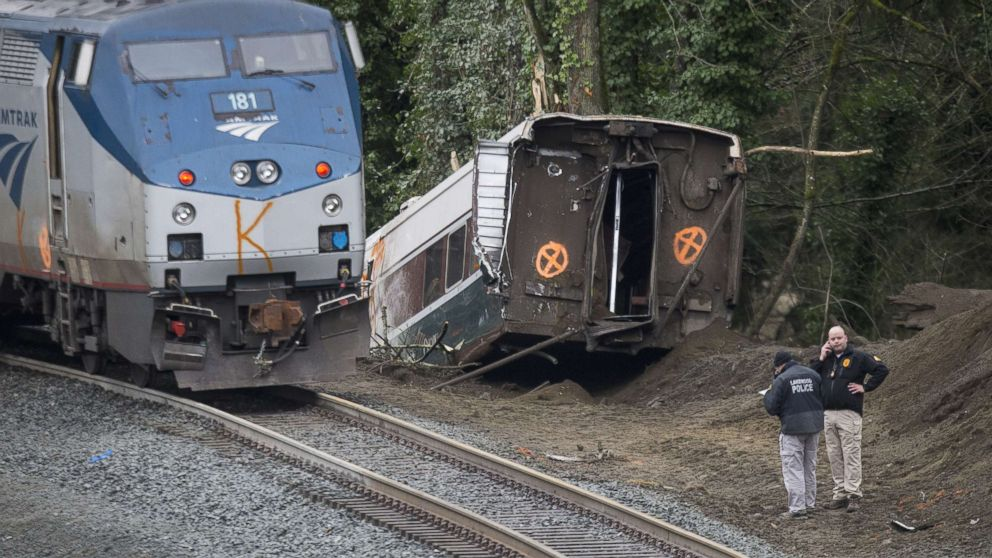 Investigators work at the scene of a Amtrak train derailment on Dec. 18, 2017 in DuPont, Wash.