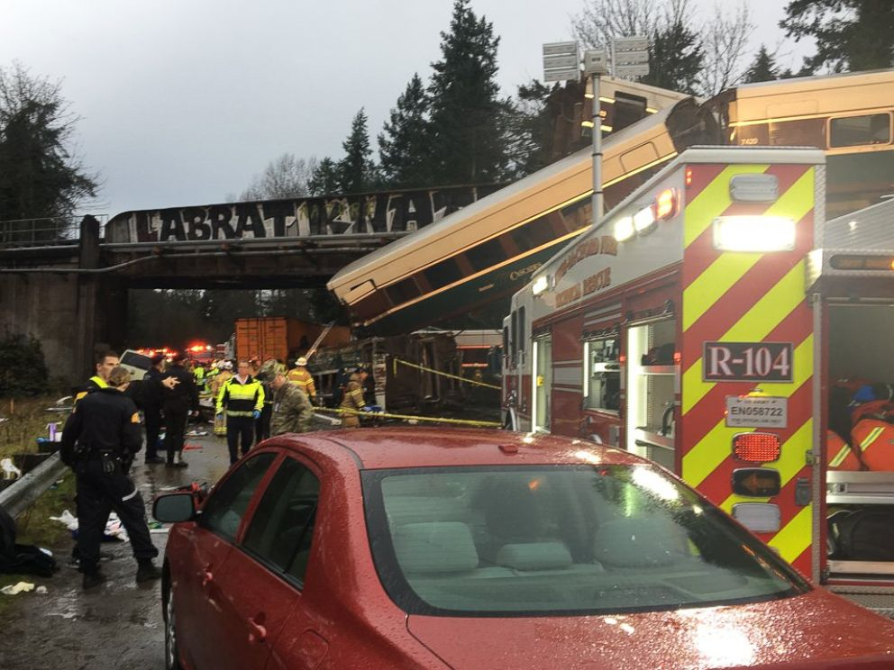 PHOTO: Emergency crews respond to the scene of a train derailment over Interstate 5 in Washington state, Dec. 18, 2017.