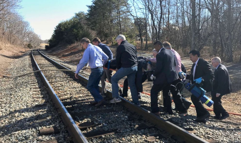 PHOTO: First responders and passengers from an Amtrak passenger train carrying members of Congress, carry one of the injured to an ambulance after the train collided with a garbage truck in Crozet, Va., Jan. 31, 2018.