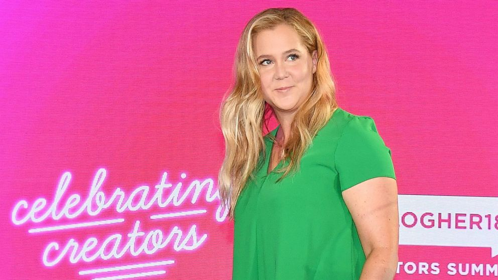 Amy Schumer walks onstage at the #BlogHer18 Creators Summit at Pier 17 on Aug. 8, 2018 in New York City.
