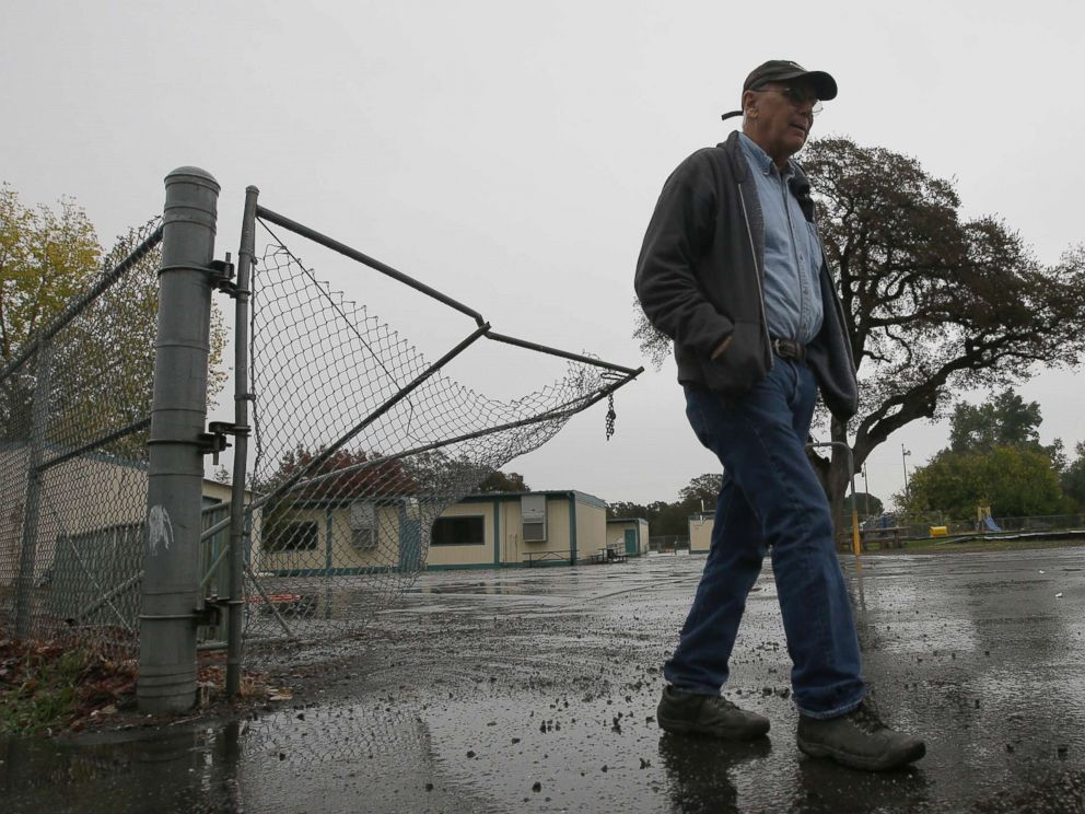 PHOTO: Randy Morehouse, the maintenance and operations supervisor for the Corning Elementary School District, walks past the gate that gunman Kevin Janson Neal crashed through during his shooting rampage at Rancho Tehama Elementary School, Nov. 15, 2017.