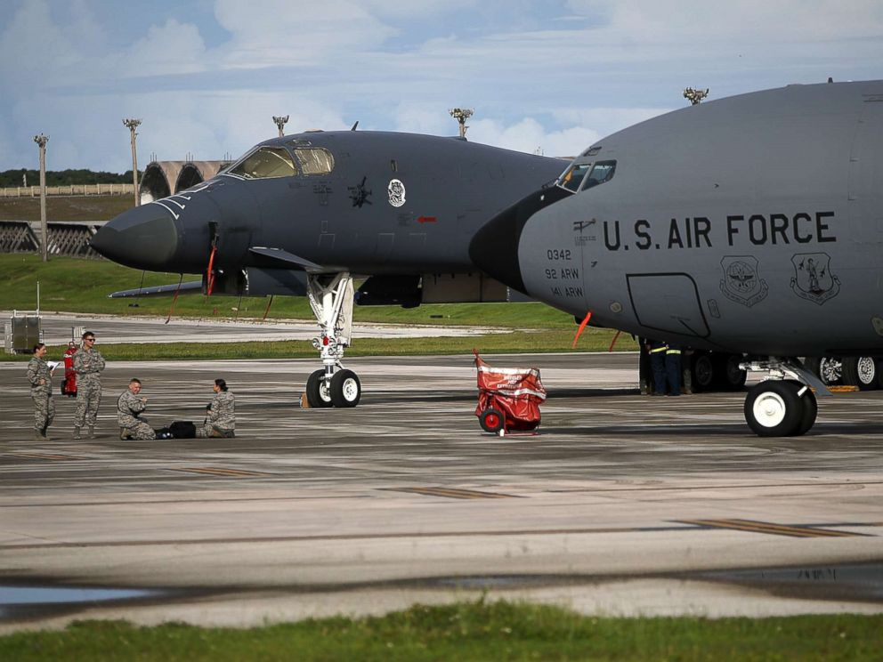 PHOTO: A U.S. Air Force Rockwell B-1B Lancer (L) and a Boeing KC-135 Stratotanker (R) sit on the tarmac at Andersen Air Force base, Aug. 17, 2017 in Yigo, Guam.