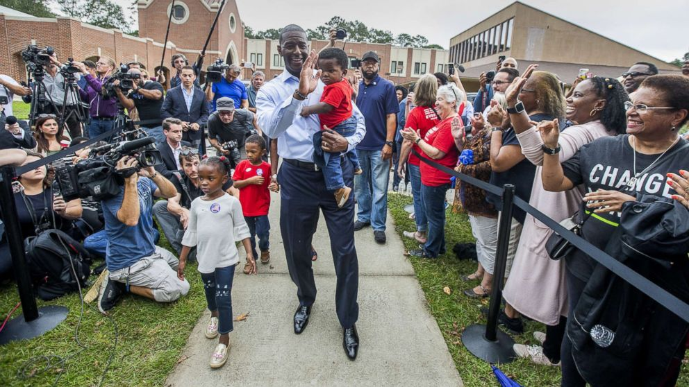 Tallahassee mayor and Florida Democratic gubernatorial candidate Andrew Gillum waves at supporters after casting his ballot with his children on Nov. 6, 2018 in Tallahassee, Fla. Gillum is in a close race against Republican candidate Ron DeSantis.