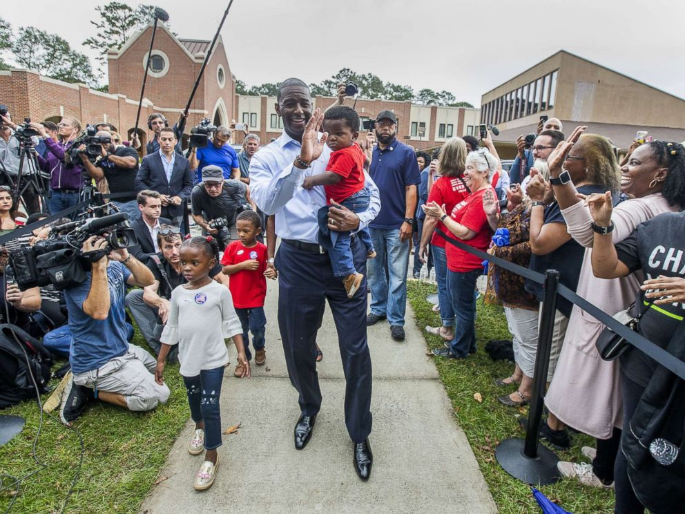 PHOTO: Tallahassee mayor and Florida Democratic gubernatorial candidate Andrew Gillum waves at supporters after casting his ballot with his children on Nov. 6, 2018 in Tallahassee, Fla.