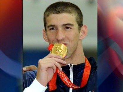 Picture of Michael Phelps with the gold medal.