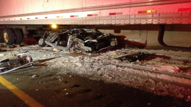 VIDEO: The couple in Kentucky suffered non-life-threatening injuries when their car was crushed by a tractor-trailer.