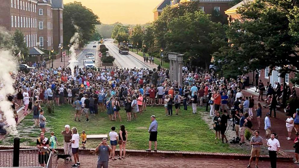 Hundreds of people attended a walking vigil in Annapolis, Md., to mourn the death of five employees of the Capital Gazette who were killed on Thursday during a shooting in the newsroom.