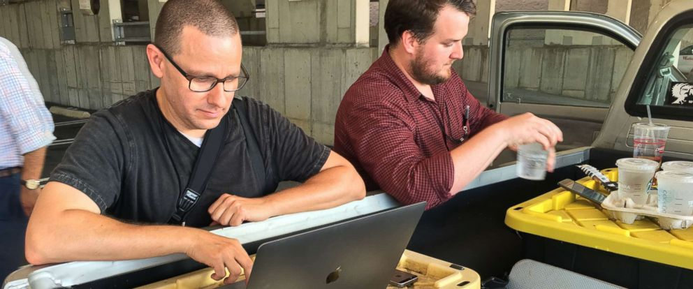 PHOTO: Capital Gazette reporter Chase Cook and photographer Joshua McKerrow work on the next days newspaper while awaiting news from their colleagues in Annapolis, Maryland, June 28, 2018.
