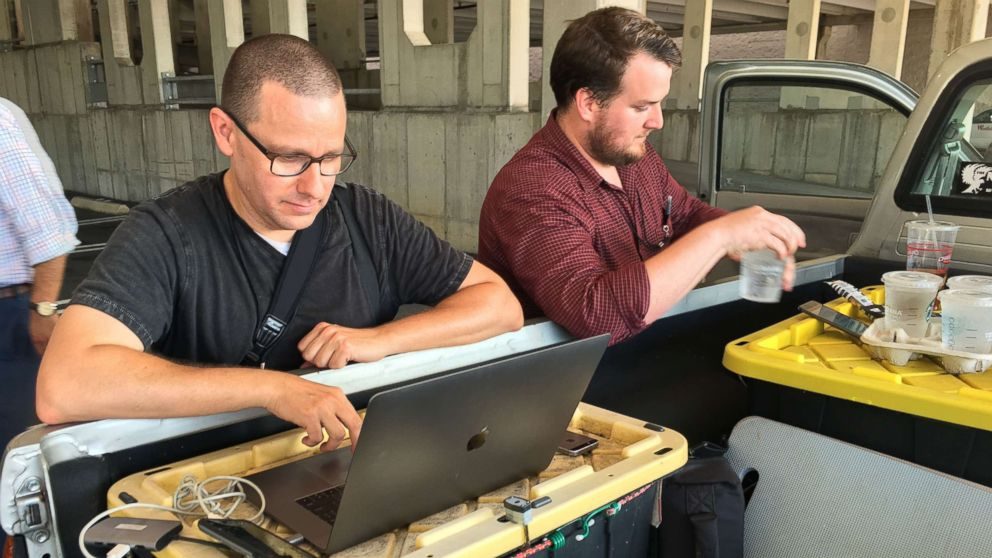 Capital Gazette reporter Chase Cook and photographer Joshua McKerrow work on the next day's newspaper while awaiting news from their colleagues in Annapolis, Maryland, June 28, 2018.