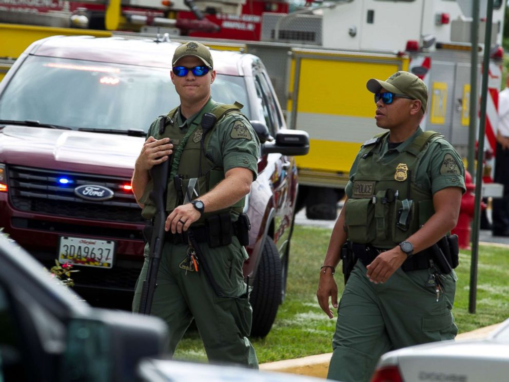 PHOTO: Maryland police officers patrol the area after multiple people were shot at at The Capital Gazette newspaper in Annapolis, Md., June 28, 2018.