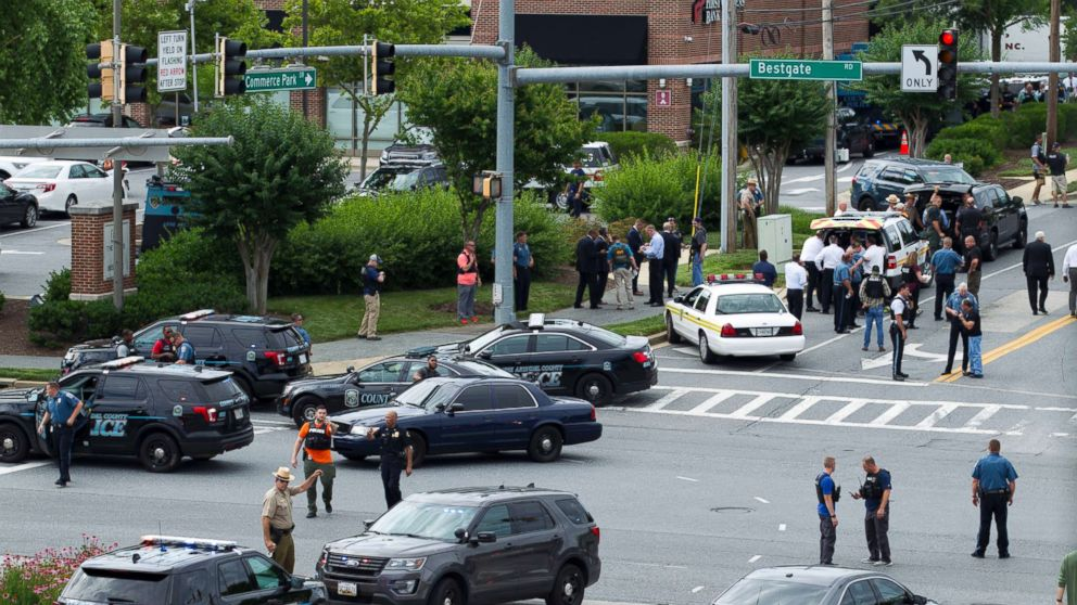 Maryland police officers block the intersection at the building entrance, after multiple people were shot at a newspaper in Annapolis, Md., June 28, 2018.