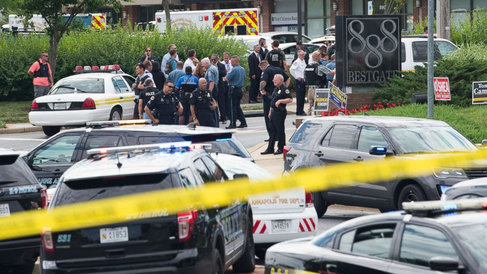 Police respond to a shooting at the offices of the Capital Gazette, a daily newspaper, in Annapolis, Md., June 28, 2018.