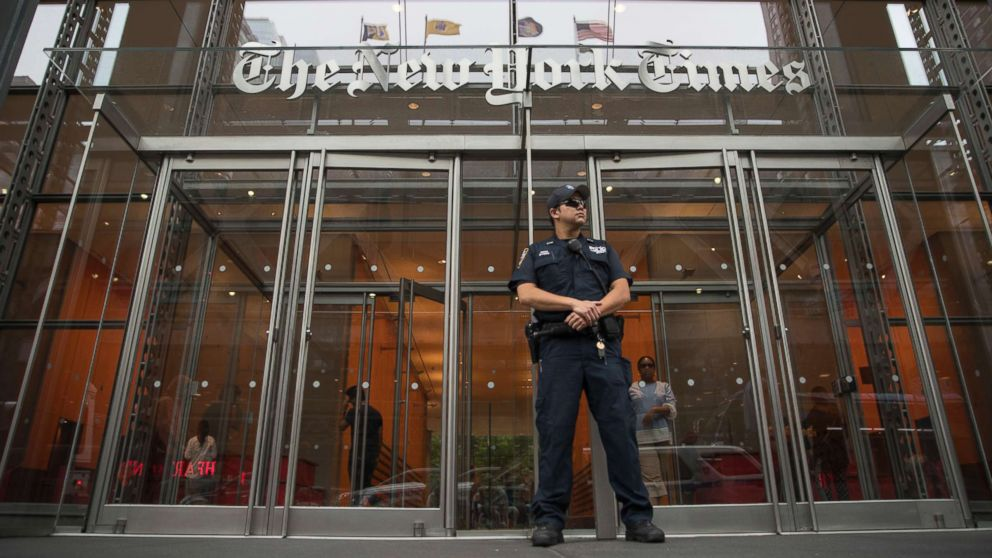 A police officer stands guard outside The New York Times building, June 28, 2018, in New York. The New York Police Department has sent patrols to major news media organizations in response to a fatal shooting at a newspaper in Annapolis, Md.