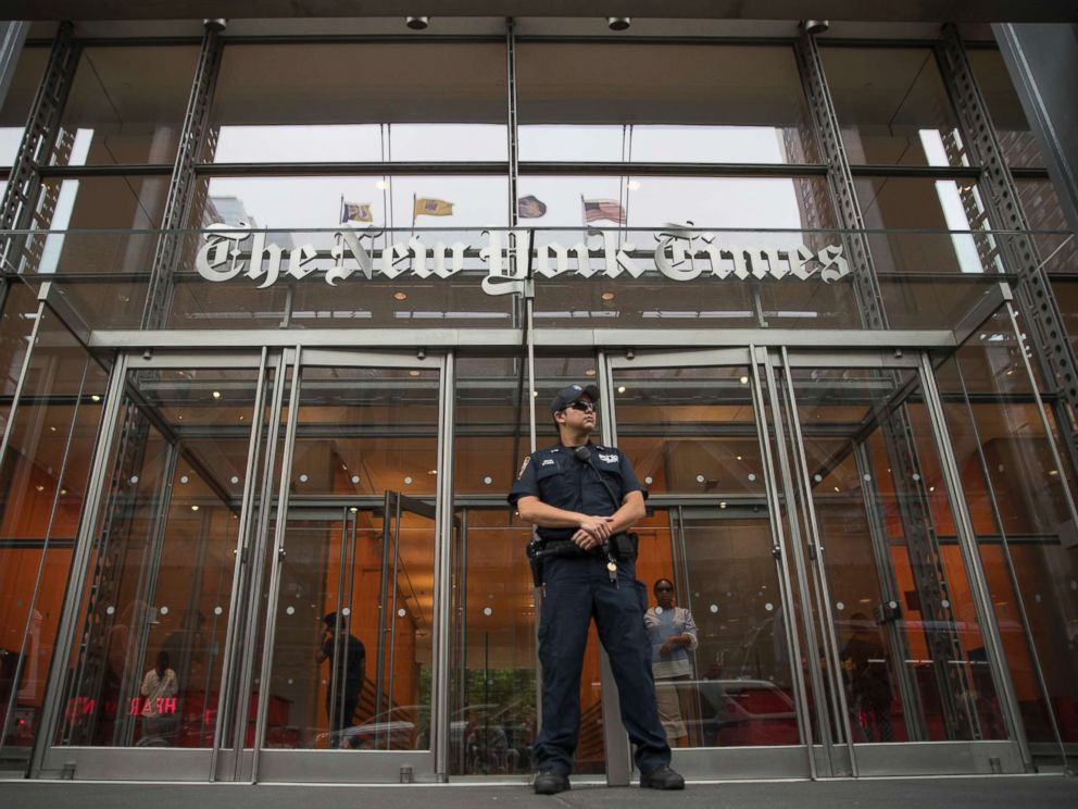 PHOTO: A police officer stands guard outside The New York Times building, June 28, 2018, in New York.