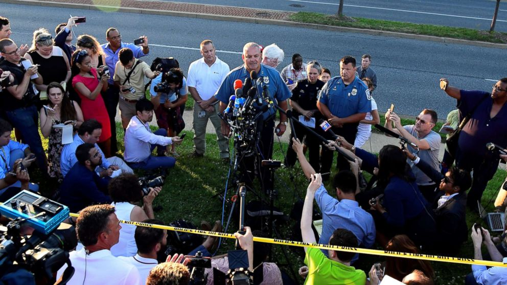 A police officer speaks to the media near the scene of a mass shooting in Annapolis, Maryland, June 28, 2018.