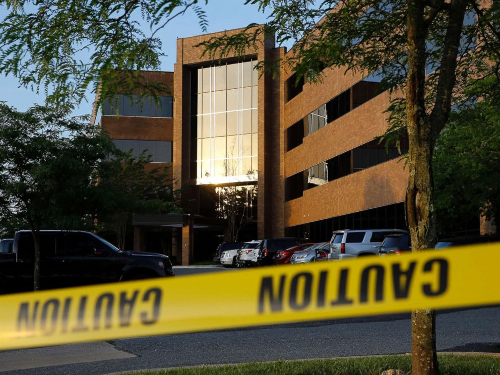 PHOTO: Crime scene tape surrounds a building housing The Capital Gazette newspapers offices, June 29, 2018, in Annapolis, Md.
