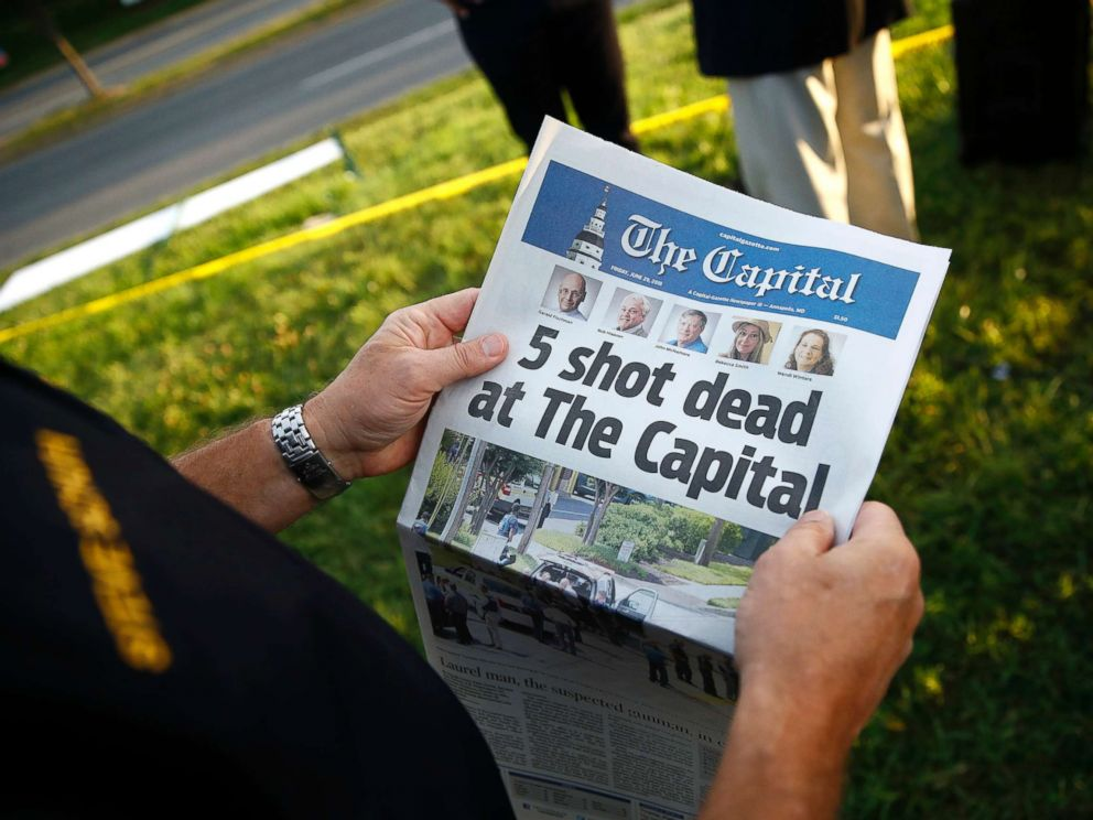 PHOTO: Steve Schuh, county executive of Anne Arundel County, holds a copy of The Capital Gazette near the scene of a shooting at the newspapers office, June 29, 2018, in Annapolis, Md.