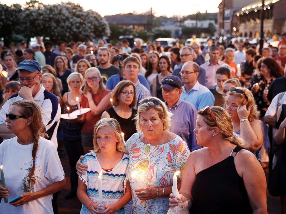 PHOTO: Mourners stand in silence during a vigil in response to a shooting at the Capital Gazette newsroom on June 29, 2018, in Annapolis, Md.