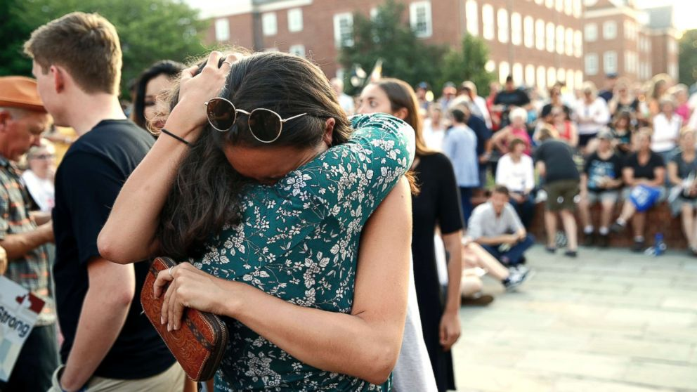 People hug as they gather for a vigil in response to a shooting in the Capital Gazette newsroom on June 29, 2018, in Annapolis, Md.